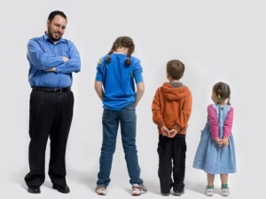 Joshua Gans and his three children.