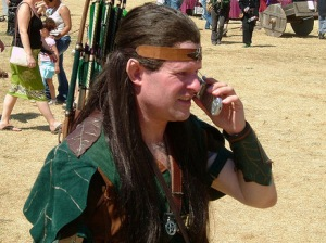 A medieval re-enactor talks on his cell phone